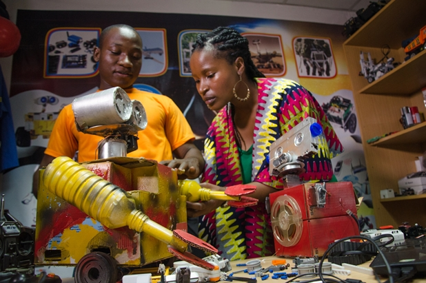 Presenter-Ndoni-Khanyile-learning-more-about-robotics-with-Ben-Nortey,-founder-and-CEO-of-the-MEtro-Institute-of-Innovation-and-Technology-in-his-office-in-Accra,-Ghana---credit-Daniel-Rutland-Manners